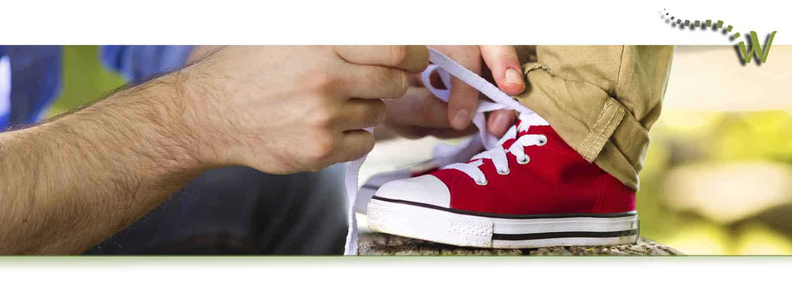 Man tying red shoe